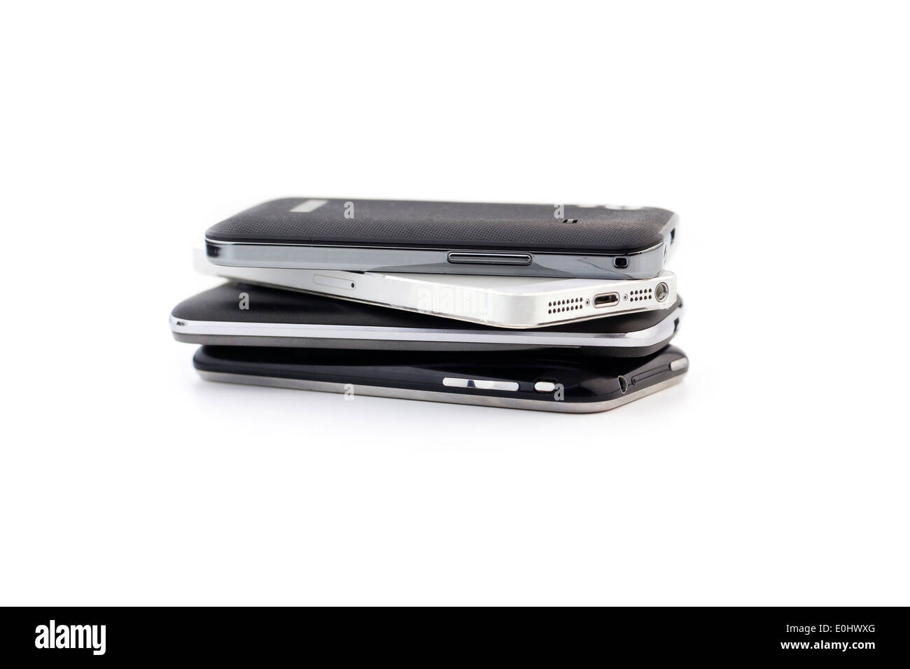 Stack of different smartphones - Stock Image