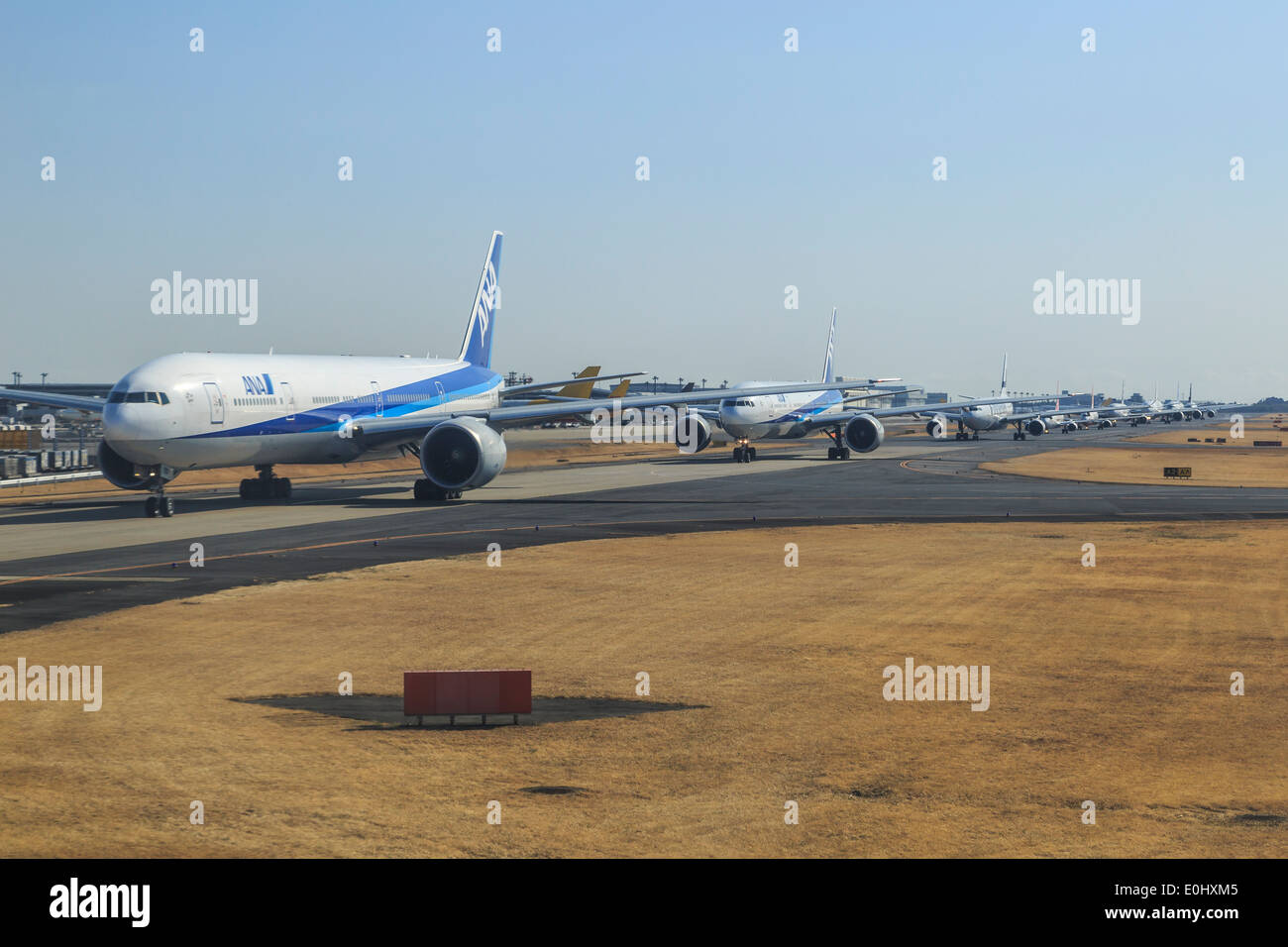 Airplanes waiting to depart - Stock Image