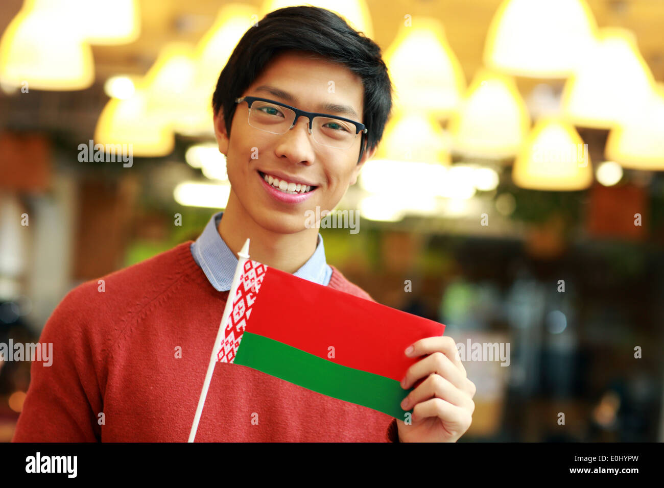Happy young asian boy holding flag of Belarus - Stock Image