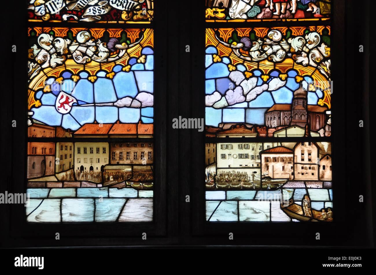 Stain glass panels portraying the Passau skyline. - Stock Image
