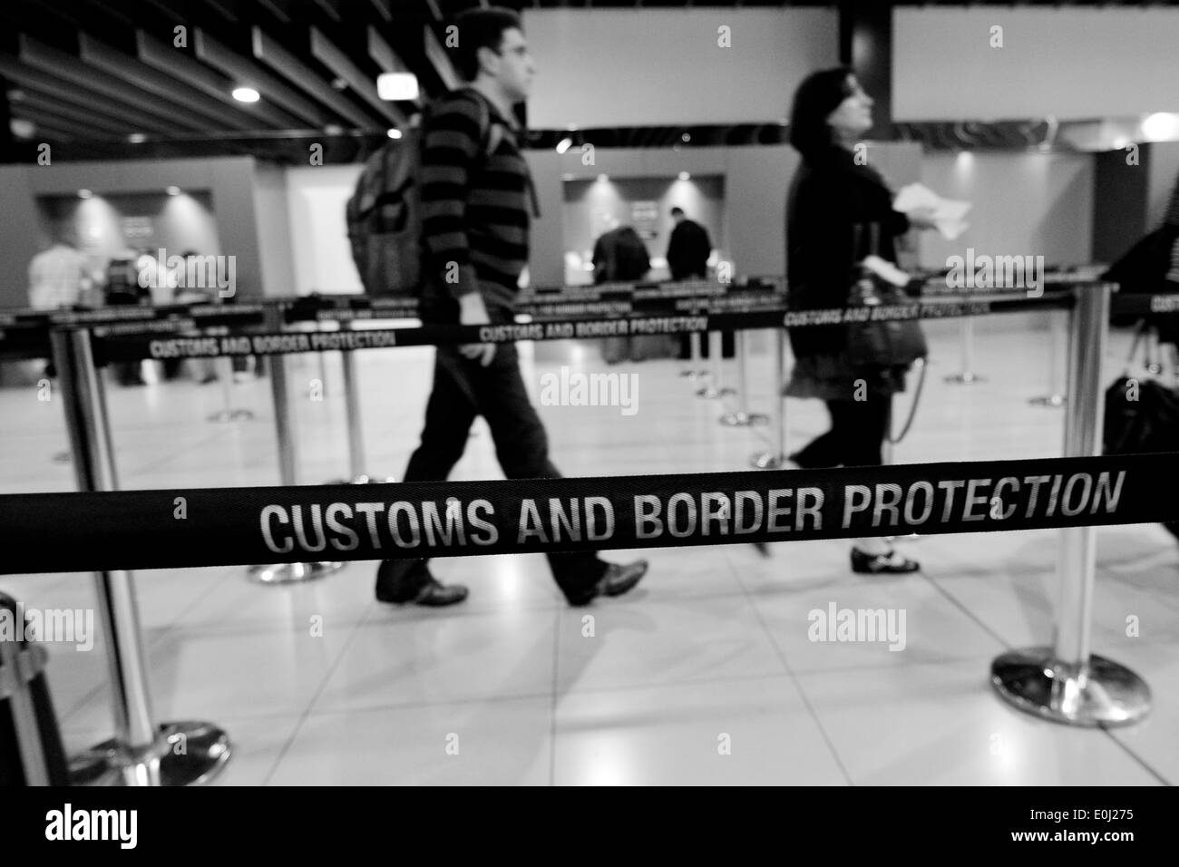 Passengers at Australian Customs and Border Protection checkpoint in Melbourne airport. - Stock Image