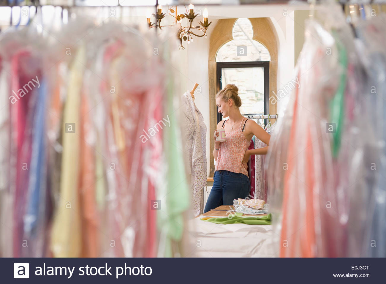 Fashion Designer Relaxing In Design Studio - Stock Image