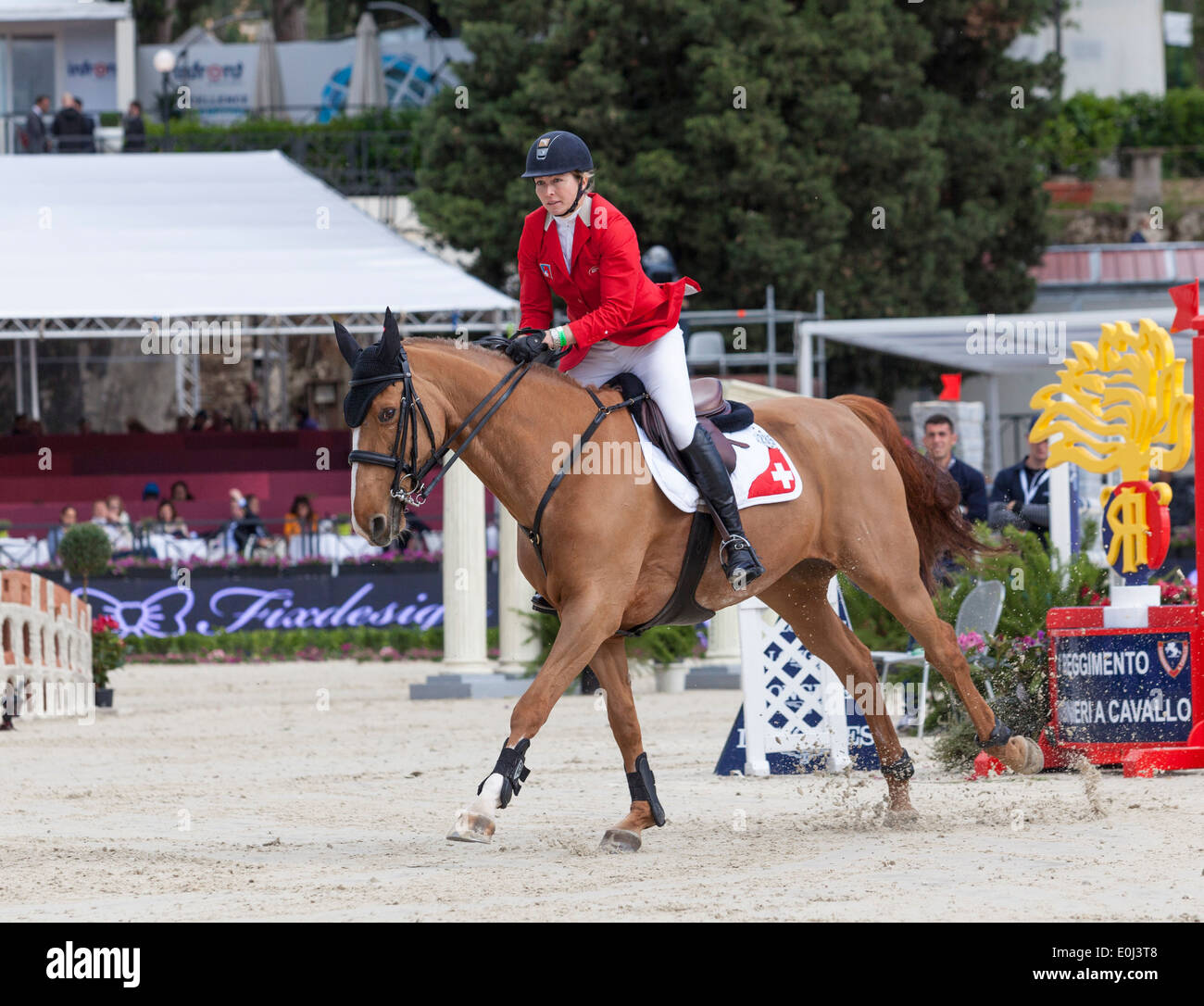 Christina Liebherr on LB Callas Sitte competing in the Furusiyya Nations Cup in Piazza di Siena show jumping event in Rome 2013. - Stock Image