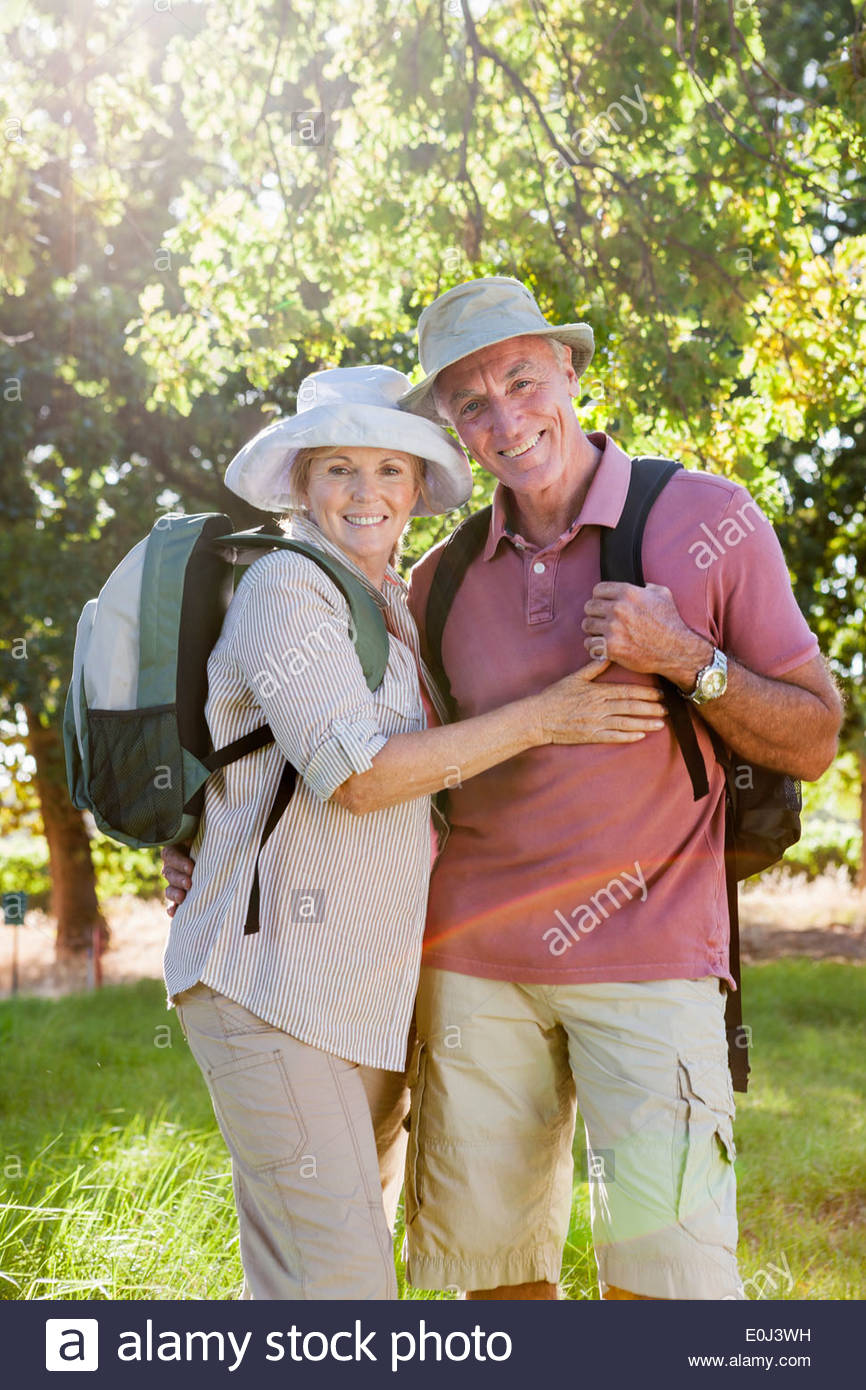 Senior Couple Hiking In Countryside - Stock Image
