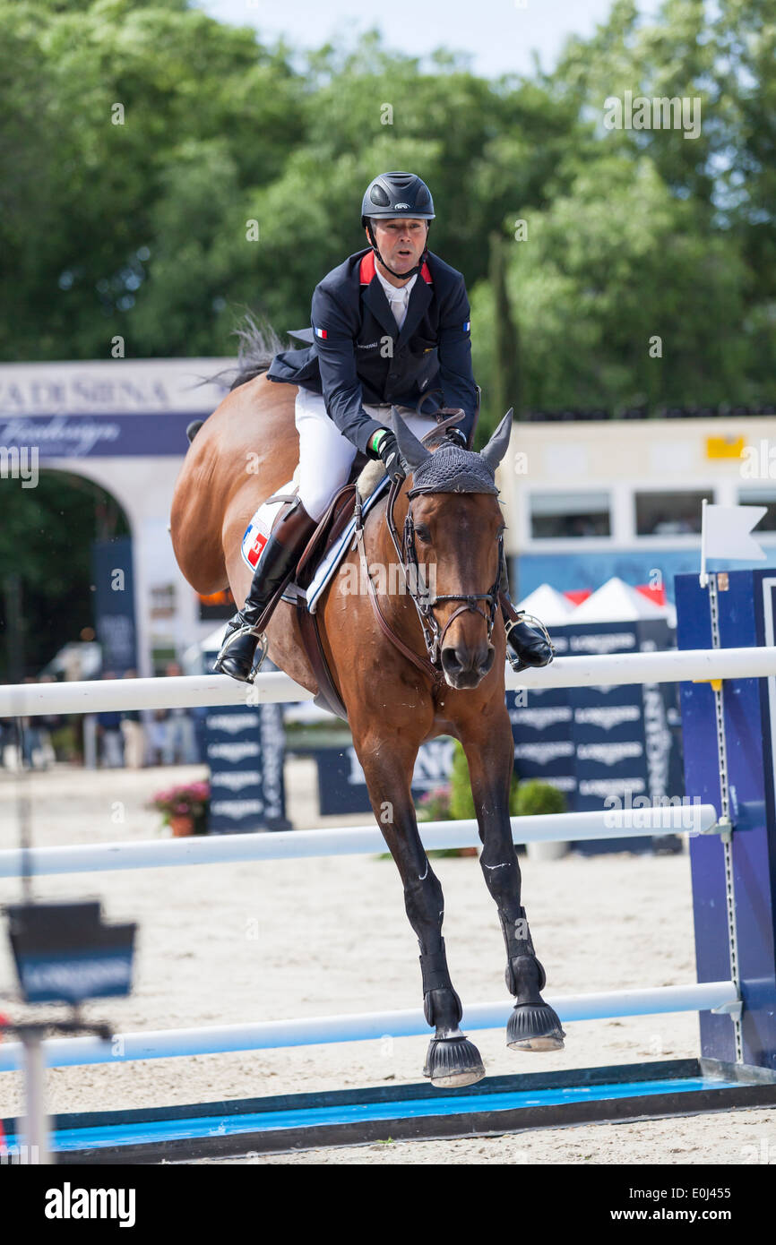 Roger-Yves Bost riding Nippon d'Elle around the Piazza di Siena course in the 2013 Furusiyya FEI Nations Cup event in Rome - Stock Image