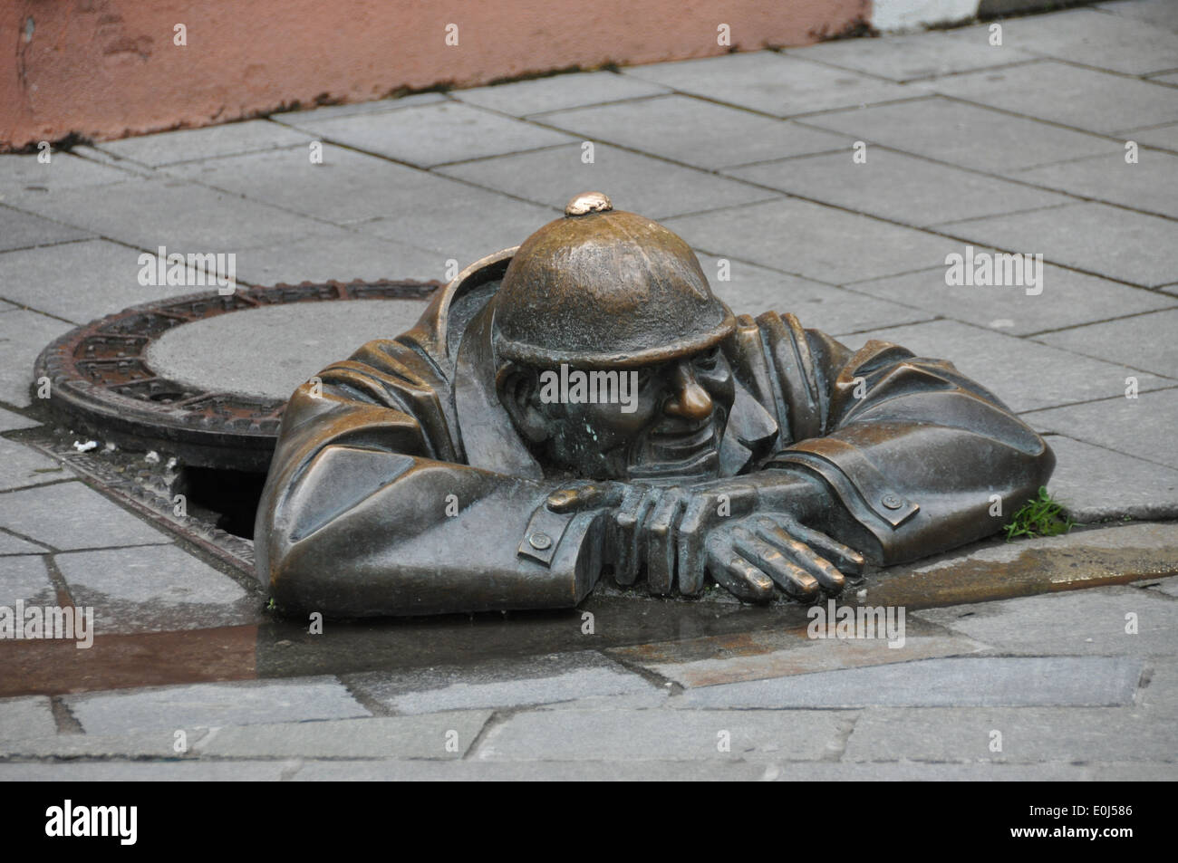A bronze statue of man in manhole bratislava s old