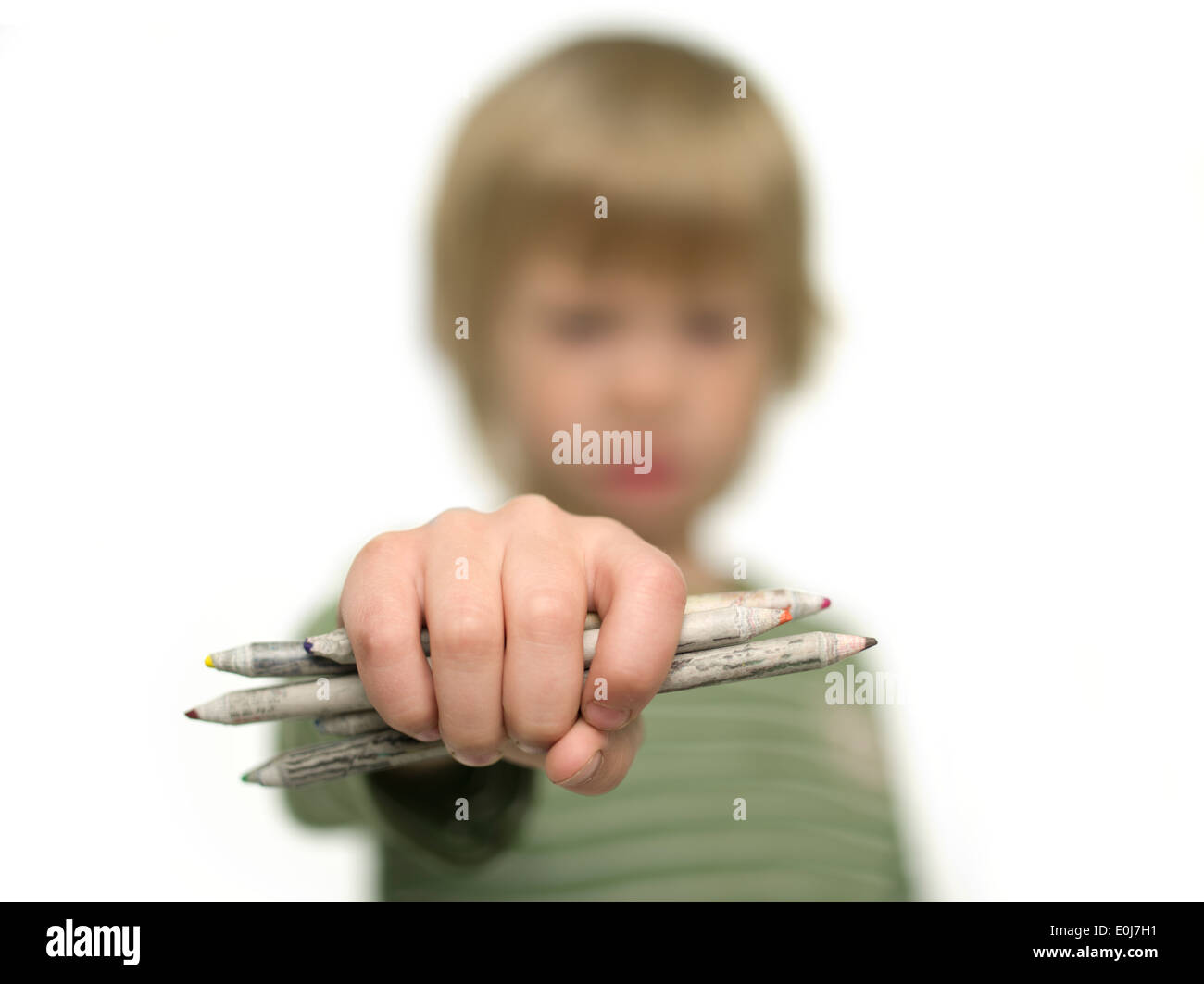 Young Boy holding showing pencils. - Stock Image