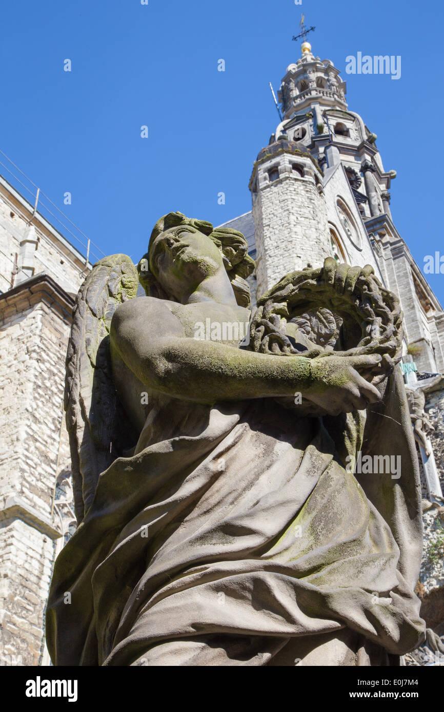 ANTWERP, BELGIUM - SEPTEMBER 5, 2013: Stone statue of angel from calvary beside St. Pauls church (Paulskerk). - Stock Image