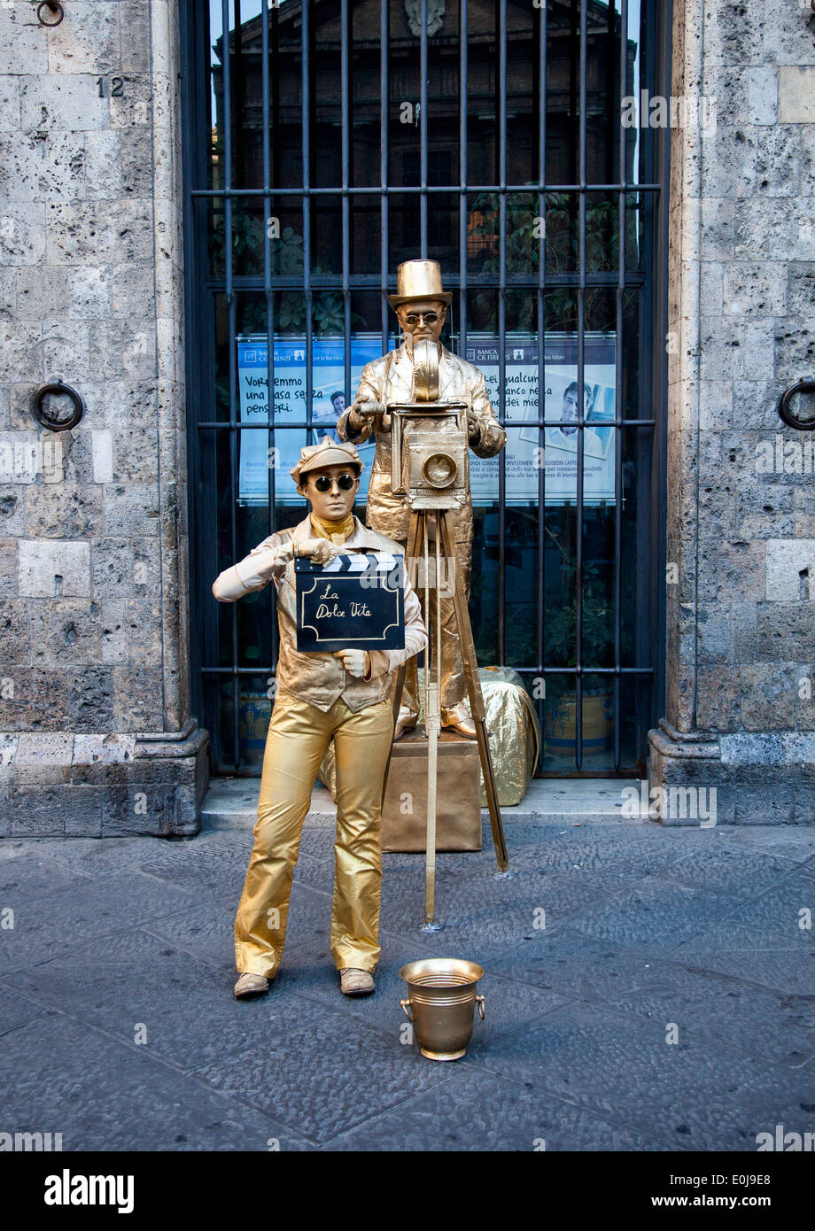 Street performers in Sienna. - Stock Image