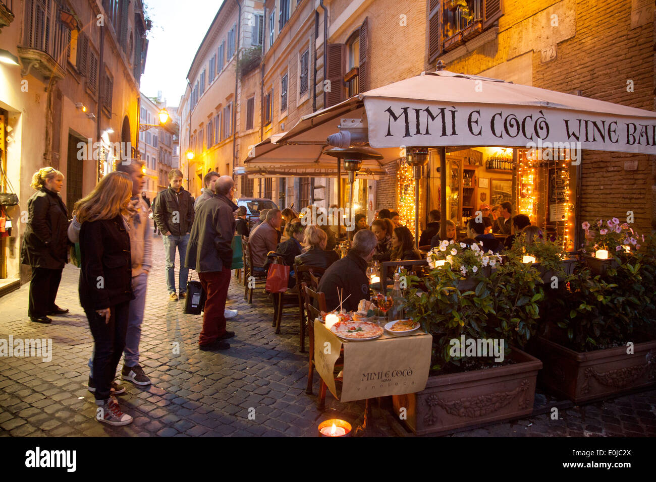 People eating at Mimi e Coco wine bar restaurant in the early evening, Rome, Italy Europe - Stock Image