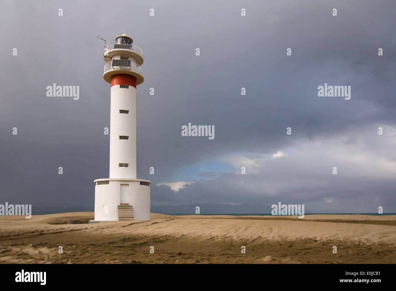 Lighthouse at the beach of El Fangar, Delta de l'Ebre (Ebro Delta), Catalonia. Stock Photo
