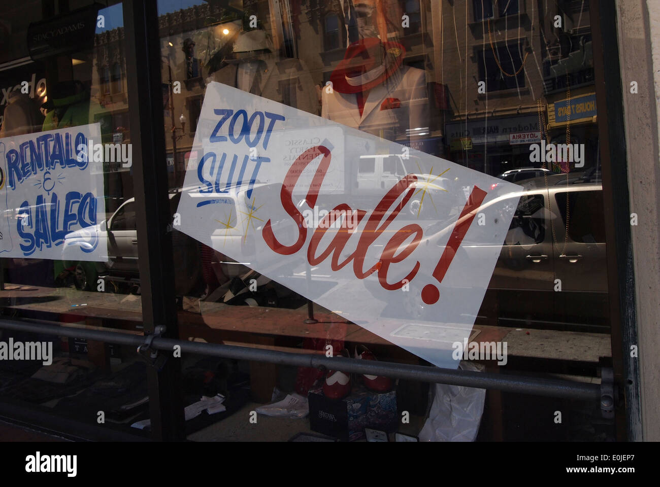 zoot suit sale sign store window Mission Street San Francisco California - Stock Image