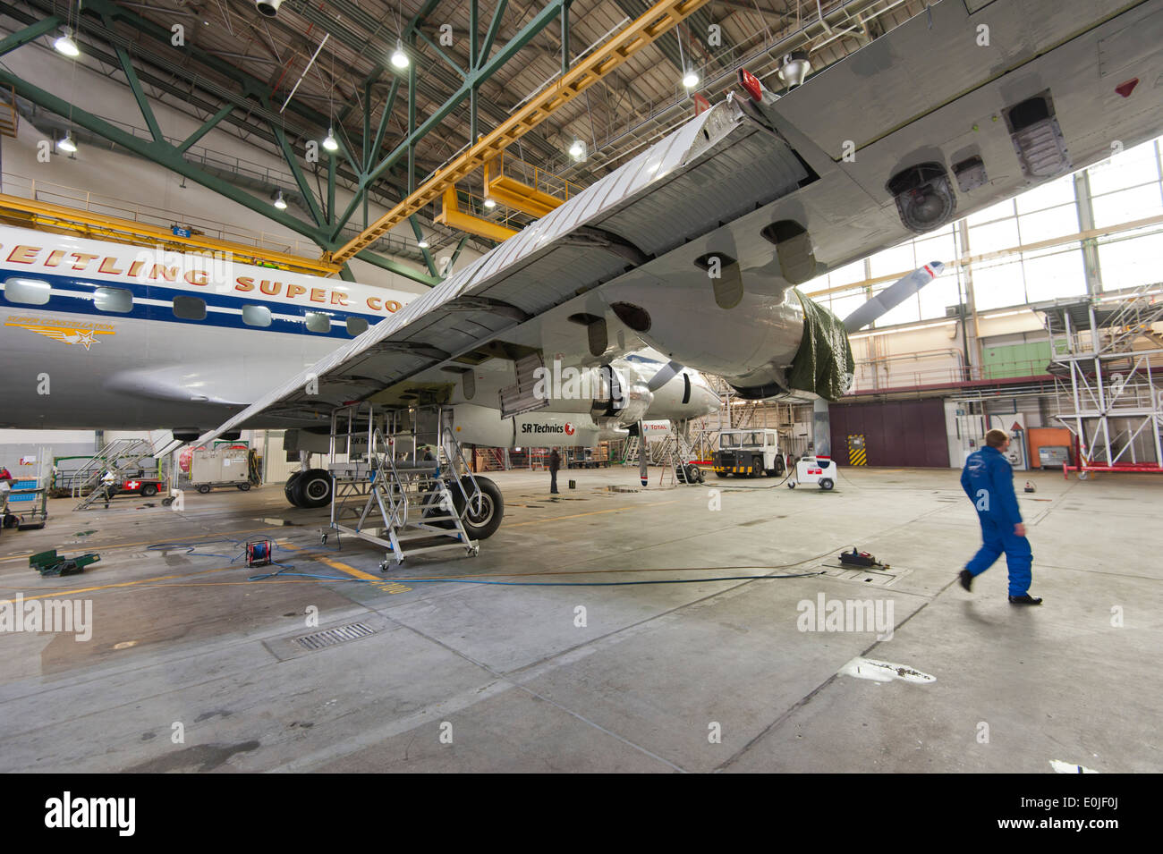 The historic passenger aircraft Lockheed Super Constellation L-1049 'HB-RSC' during maintenance in a hangar in Zurich/Kloten. - Stock Image
