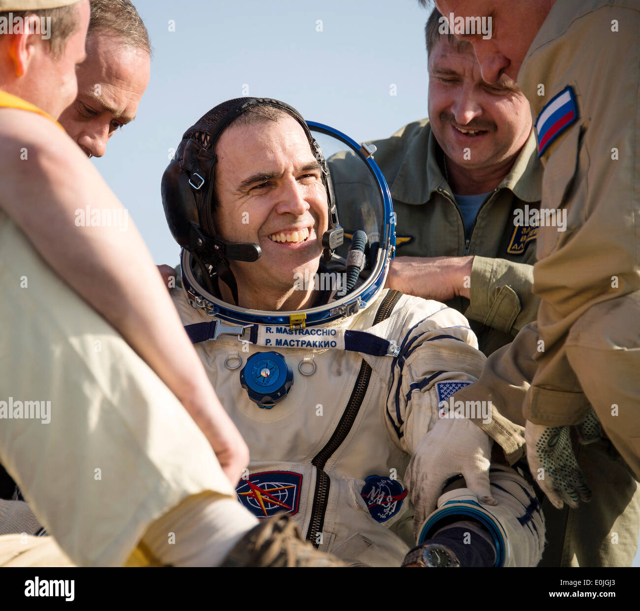 ISS Expedition 39 Flight Engineer Rick Mastracchio of NASA is helped out of the capsule just minutes after landing with fellow expedition crew members in the Soyuz TMA-11M spacecraft May 14, 2014 near the town of Zhezkazgan, Kazakhstan. Wakata, Tyurin and Mastracchio returned to Earth after more than six months onboard the International Space Station where they served as members of the Expedition 38 and 39 crews. - Stock Image