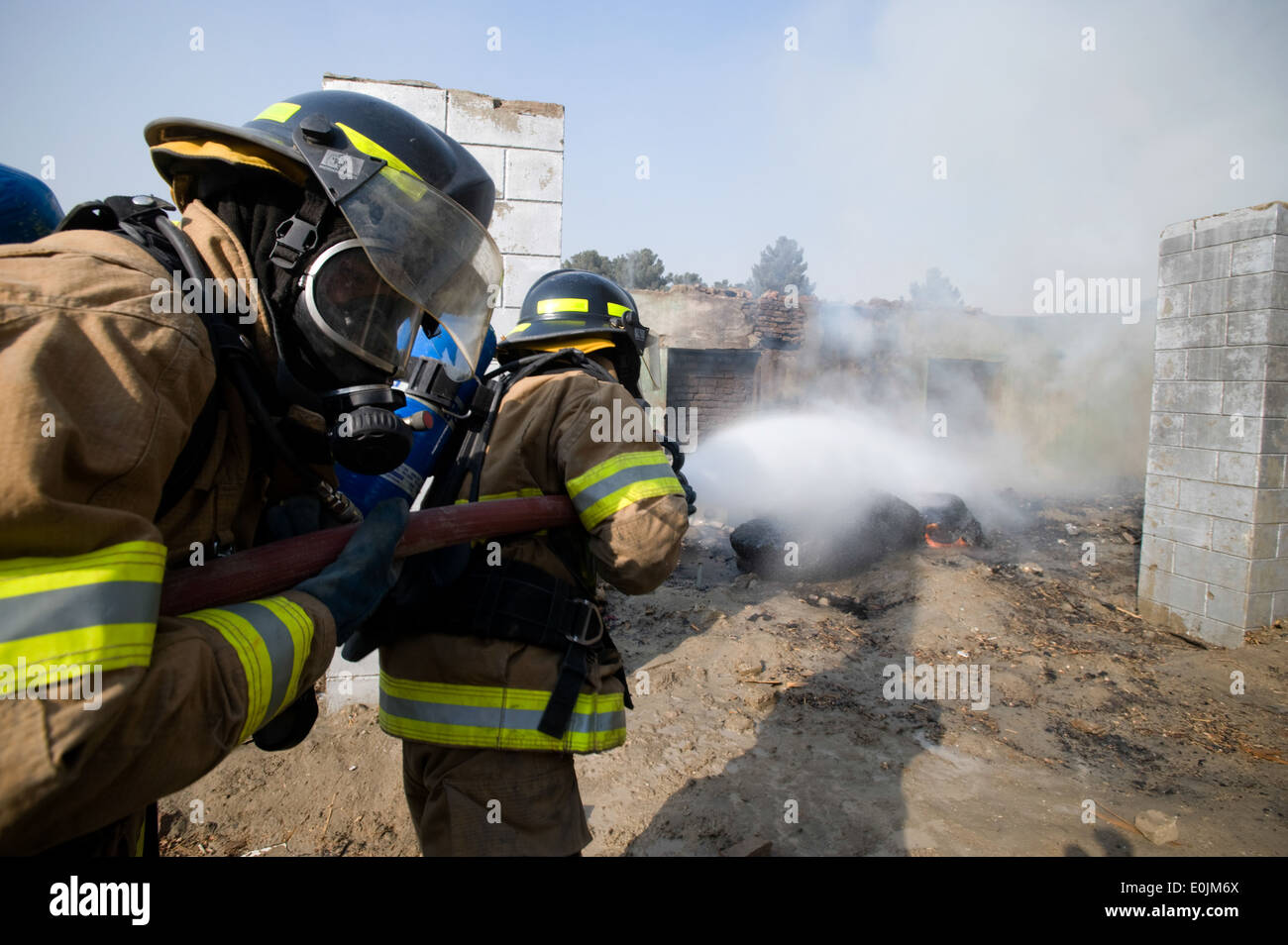 KABUL, Afghanistan --Members of the Afghan National Air Corps fire protection unit respond a fire intentionally Stock Photo