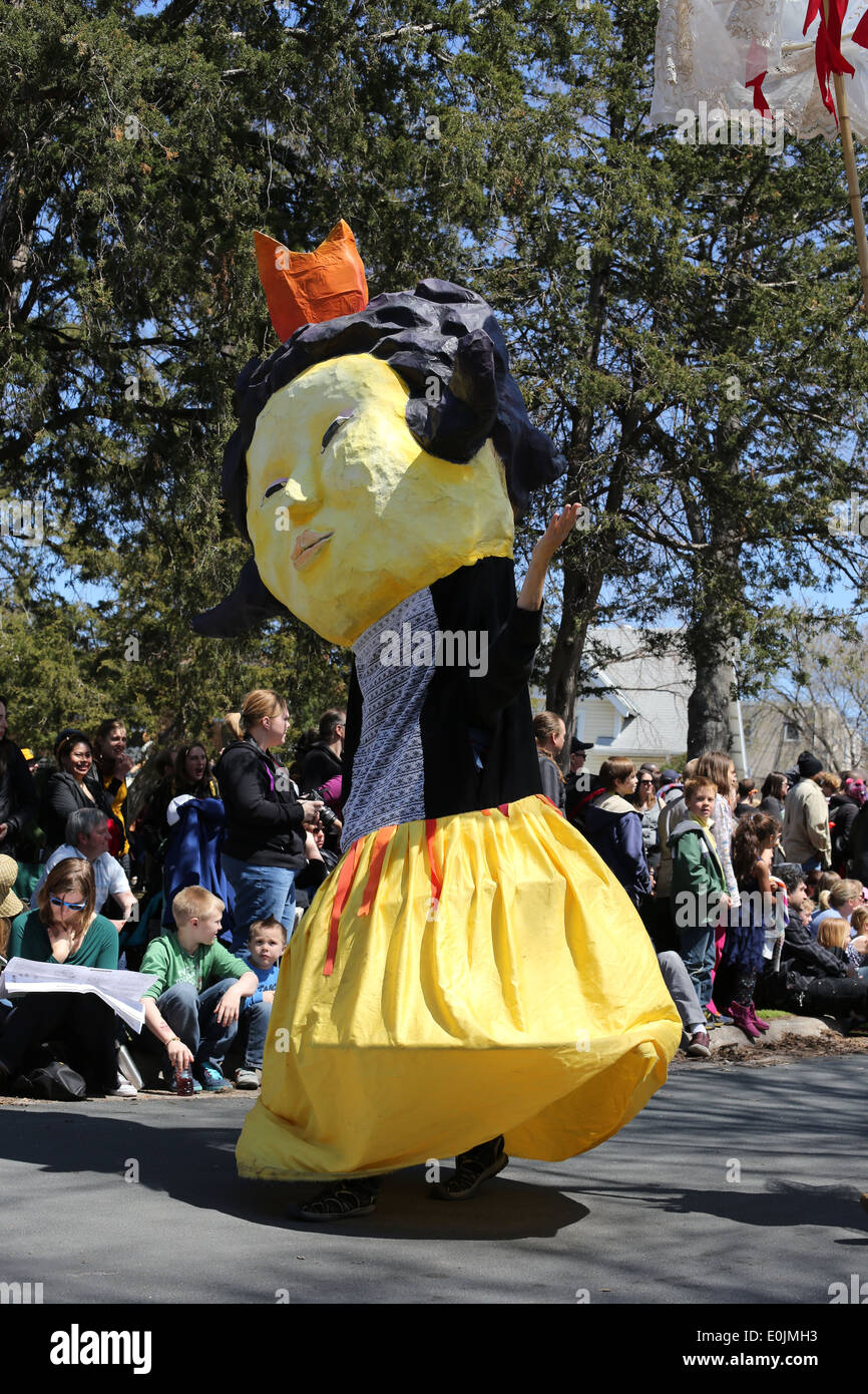 A person in a Queen bee costume at the May day parade in Minneapolis 2014. - Stock Image