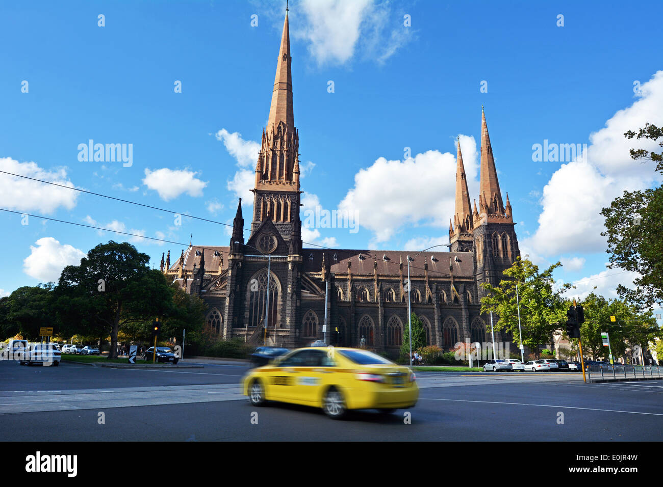 Taxicab under St Patrick's Cathedral in Melbourne Victoria Australia - Stock Image