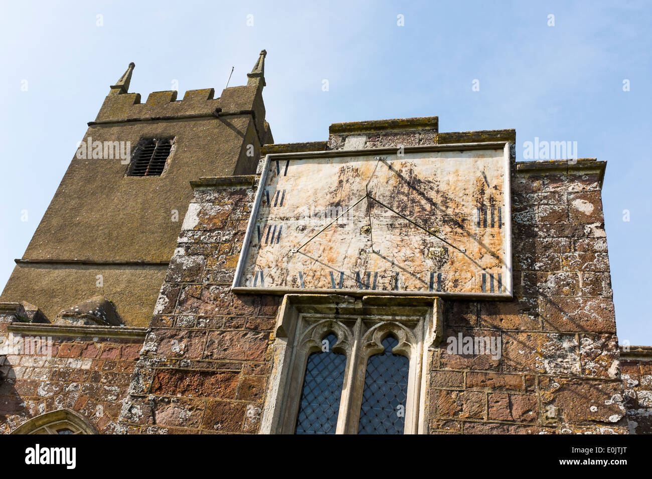 Sundial on the front of St Matthew's Church, Cheriton Fitzpaine, Devon, United Kingdom - Stock Image