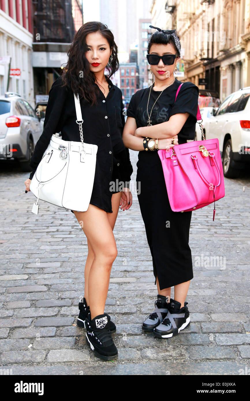 Sabrina Xin and Candy Zong walking in New York City - May 12, 2014 - Photo: Runway Manhattan/Charles Eshelman Stock Photo