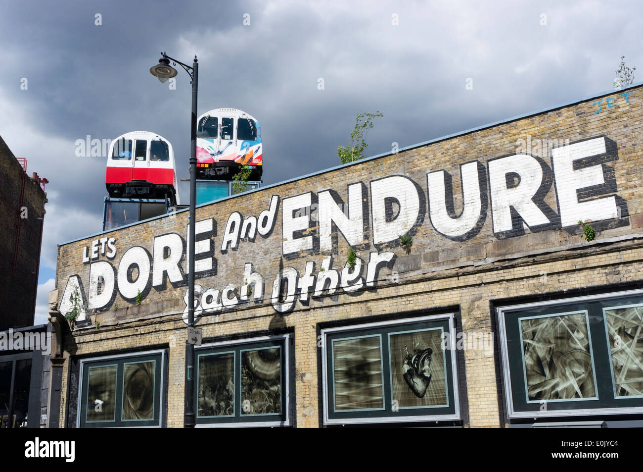 'Lets Adore and Endure Each Other' graffiti in Great Eastern Street, London. - Stock Image