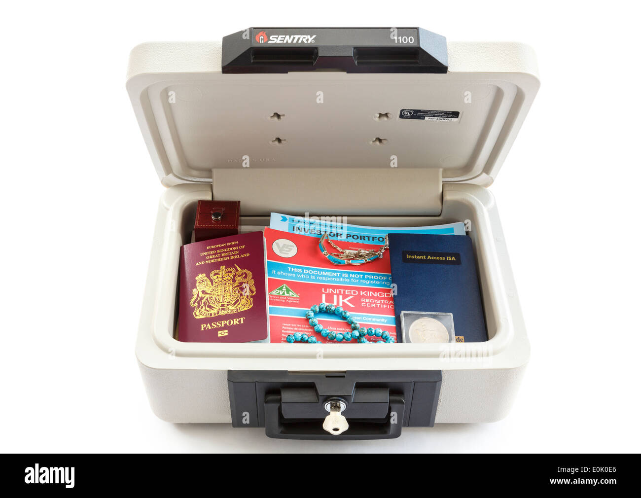 Sentry fire-safe security chest with lid open containing valuable items important paper documents to protect important things against fire damage - Stock Image