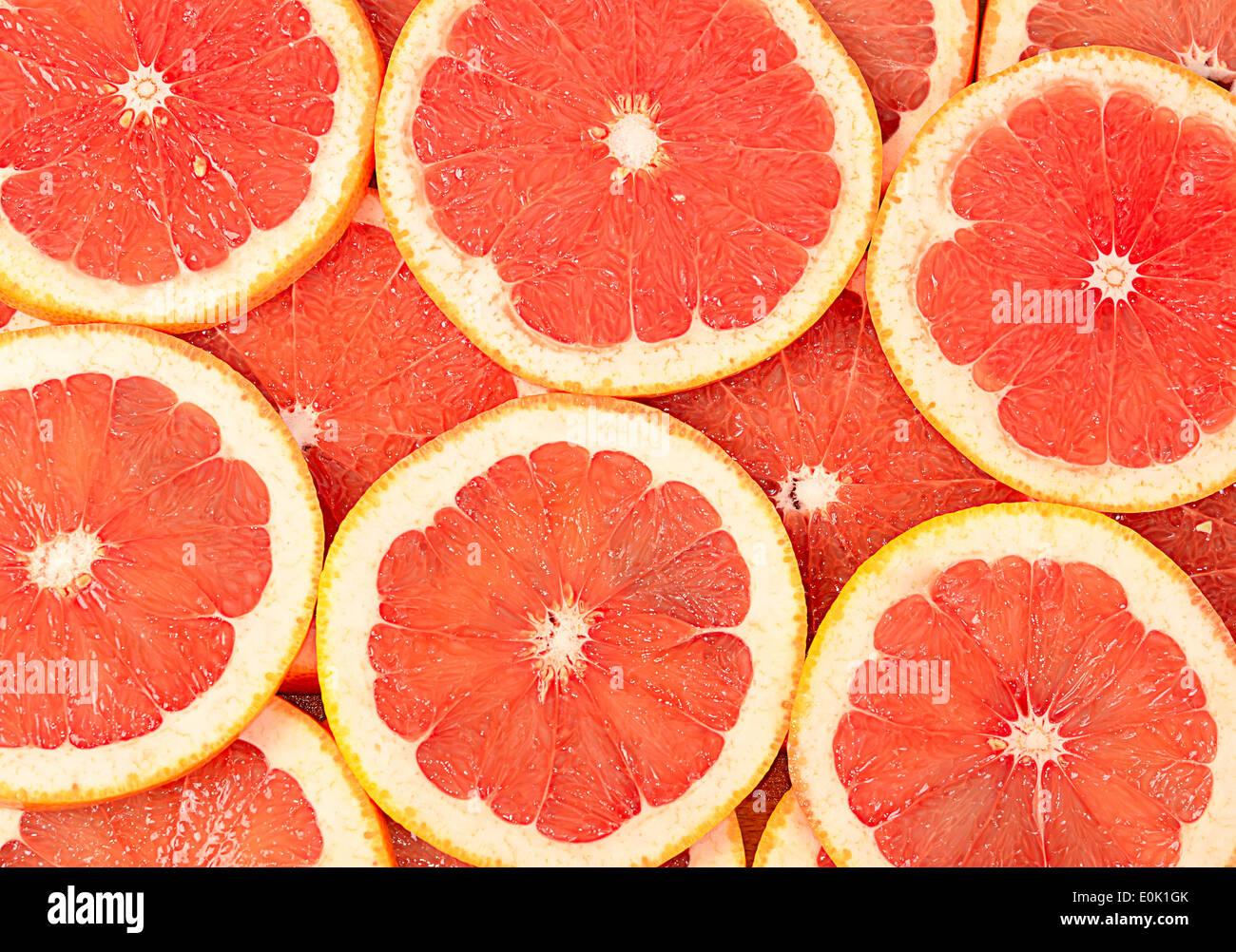 The fresh grapefruit as a background closeup - Stock Image