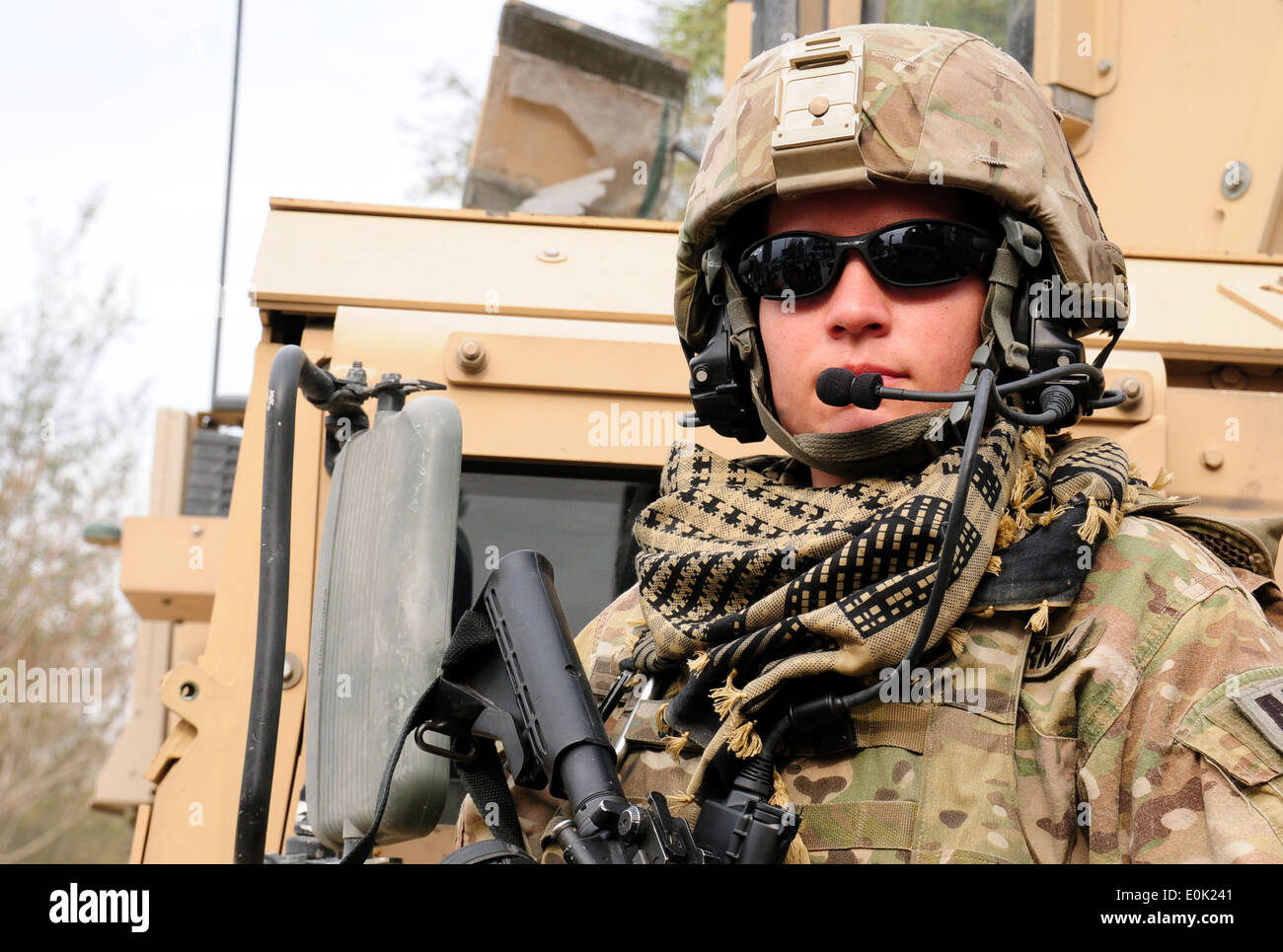 Task Force Spartan 3 soldier Army Spc. Rhesa Schubbe provides security for her team while Afghan National Police officers condu - Stock Image