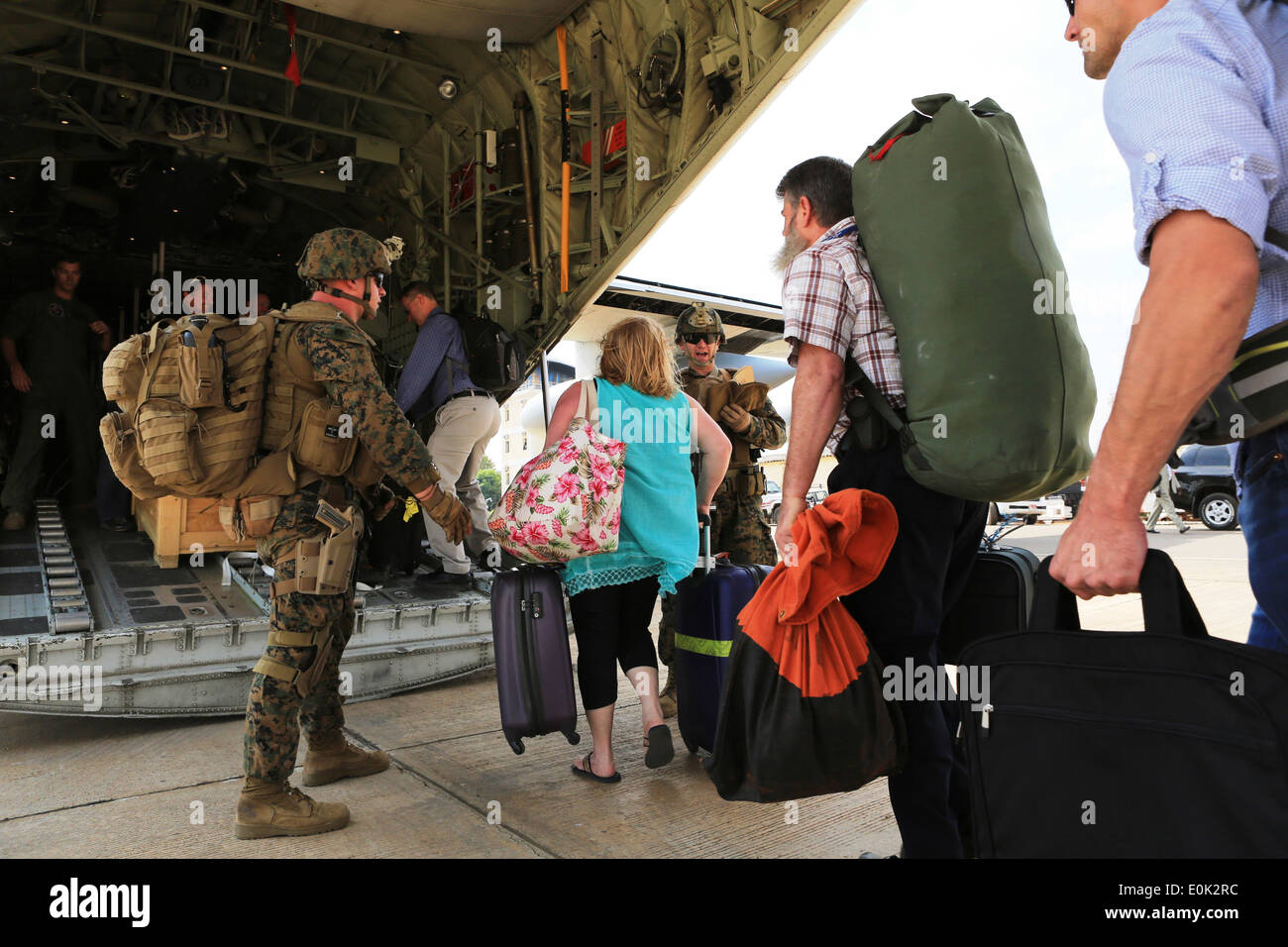 Marines and sailors with Special-Purpose Marine Air-Ground Task Force Crisis Response help U.S. citizens into a Stock Photo