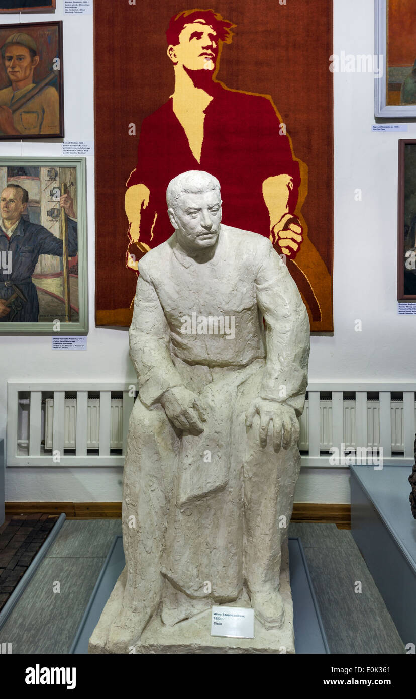 Sculpture of Stalin, communist propaganda poster, Socialist Realism Art Gallery, Zamoyski Palace in Kozlowka near Lublin, Poland - Stock Image