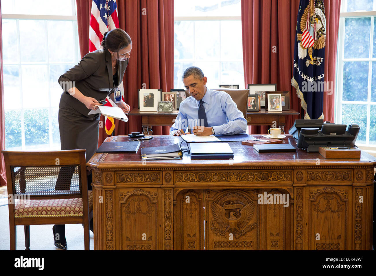 us president office. US President Barack Obama With Staff Secretary Joani Walsh, Signs Bills In The Oval Office Of White House March 21, 2014 Washington, DC Us O