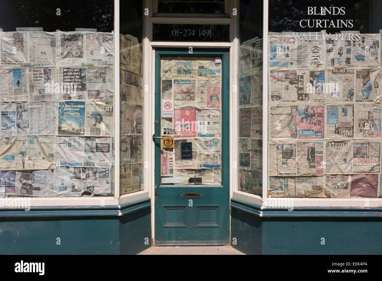 Good Newspaper Obscuring The Windows And Doorway Of A Closed Shop Business In  South London.