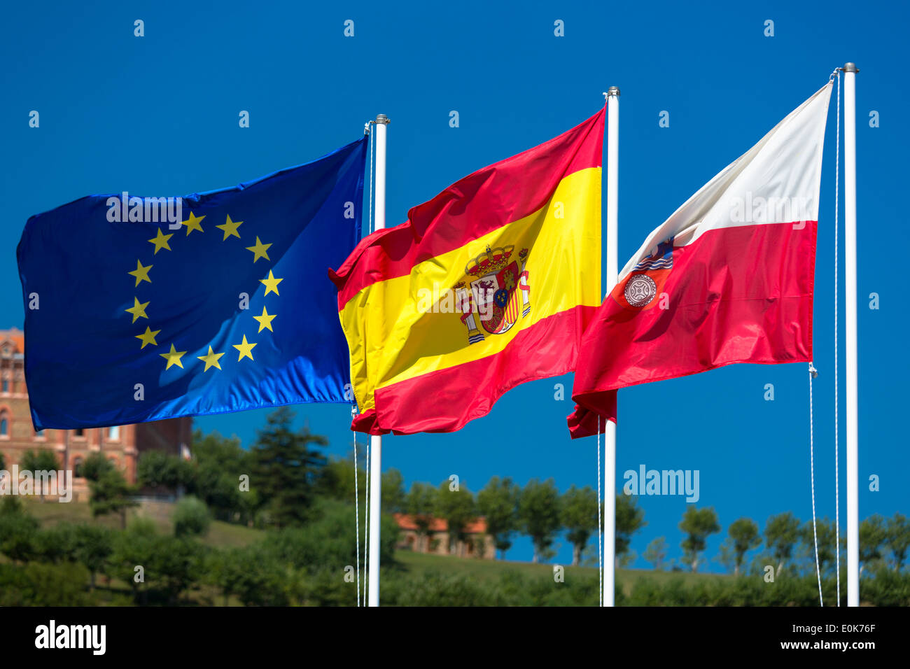 Flags of Spain, European Union and Cantabria in Comillas, Cantabria, Northern Spain Stock Photo