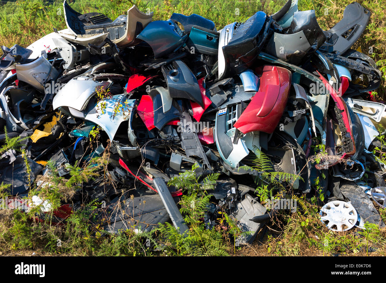 Broken car body parts for metal recycling at Renault motor dealers in Asturias, Northern Spain - Stock Image