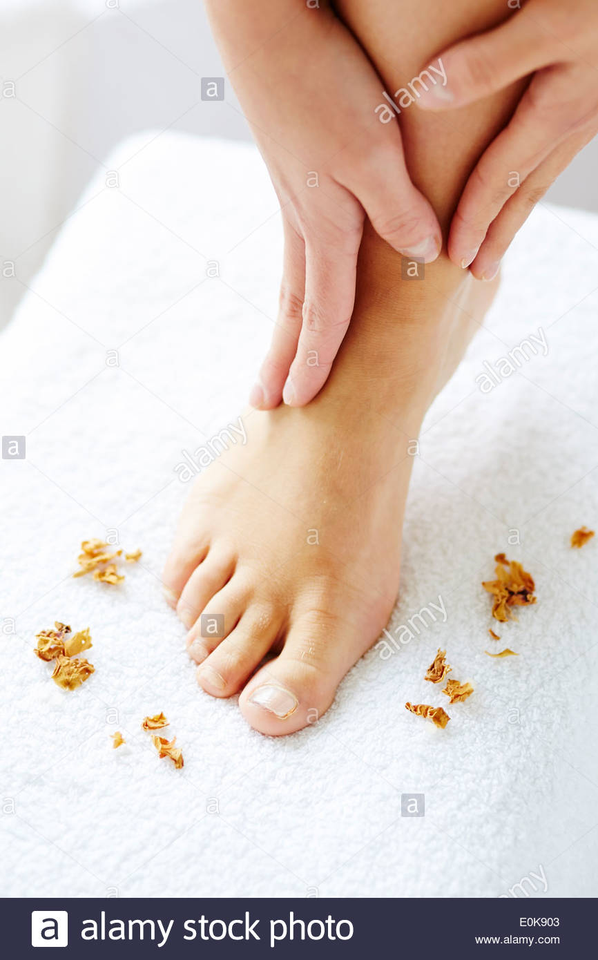 Woman massaging feet - Stock Image