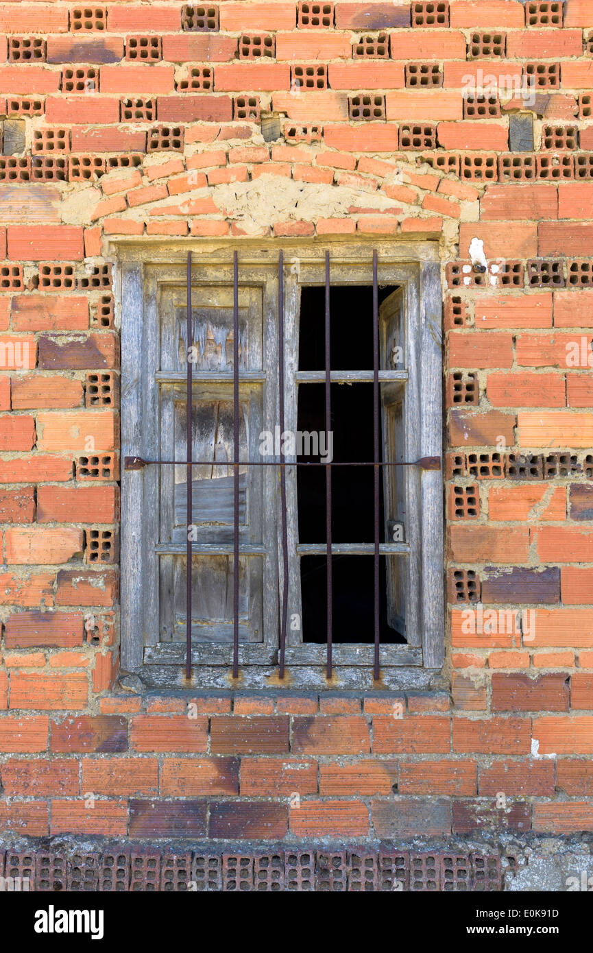 Metal Bars On Window With Shutters In Small Town Of Calzada