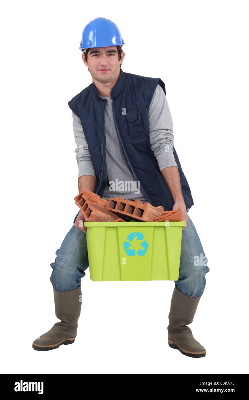 Man recycling bricks - Stock Image