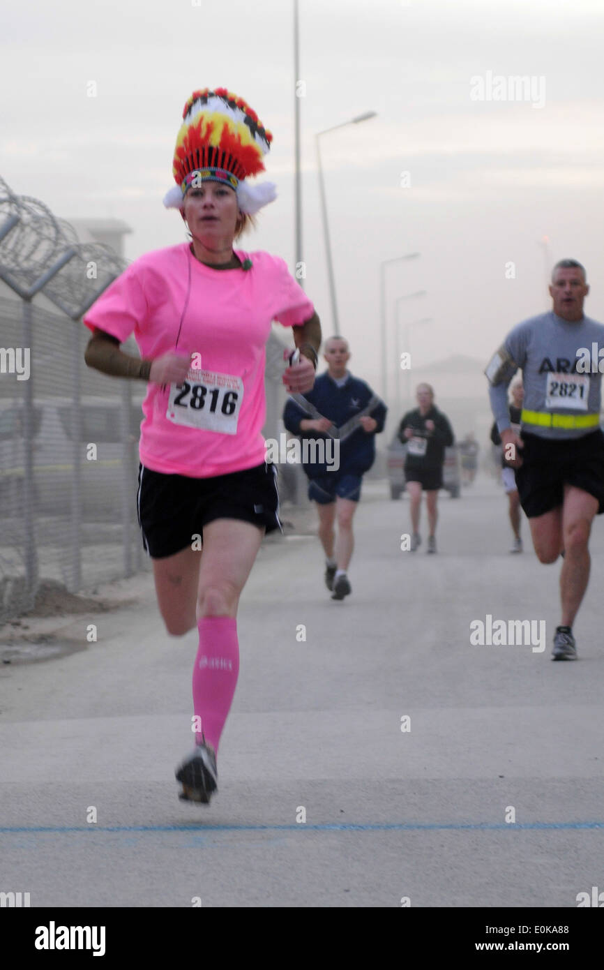 Capt. Angela Perkins, Combined Joint Psychological Operations Task Force, sprints to the finish line, Nov. 24, during the 31st - Stock Image