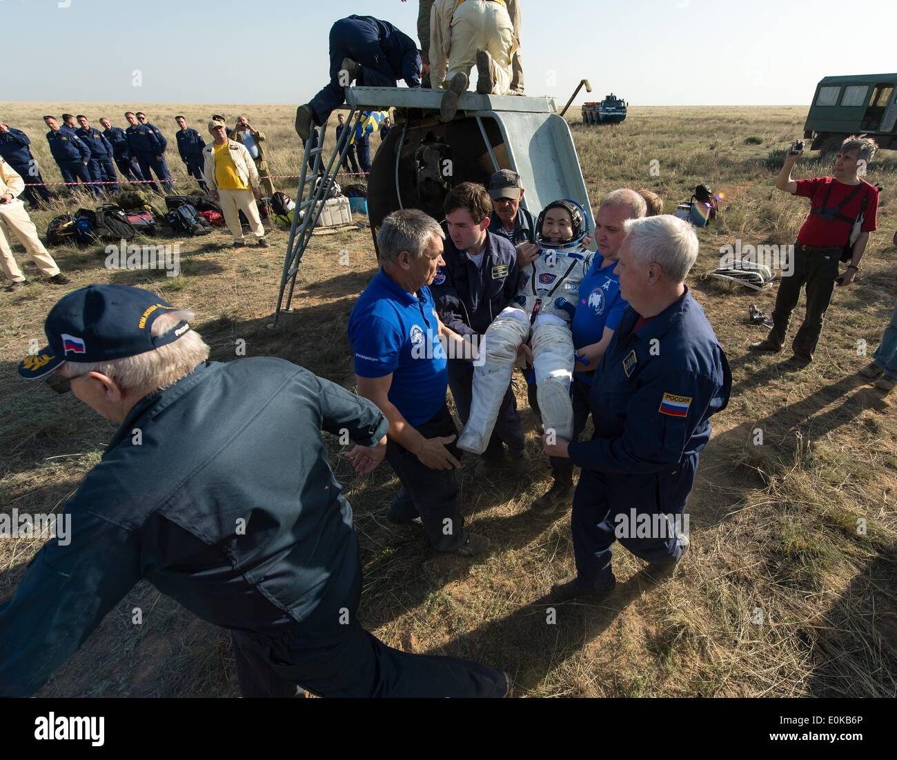 ISS Expedition 39 Commander Koichi Wakata of the Japan Aerospace Exploration Agency is carried to the medical tent just minutes after landing with fellow expedition crew members in the Soyuz TMA-11M spacecraft May 14, 2014 near the town of Zhezkazgan, Kazakhstan. Wakata, Tyurin and Mastracchio returned to Earth after more than six months onboard the International Space Station where they served as members of the Expedition 38 and 39 crews. - Stock Image