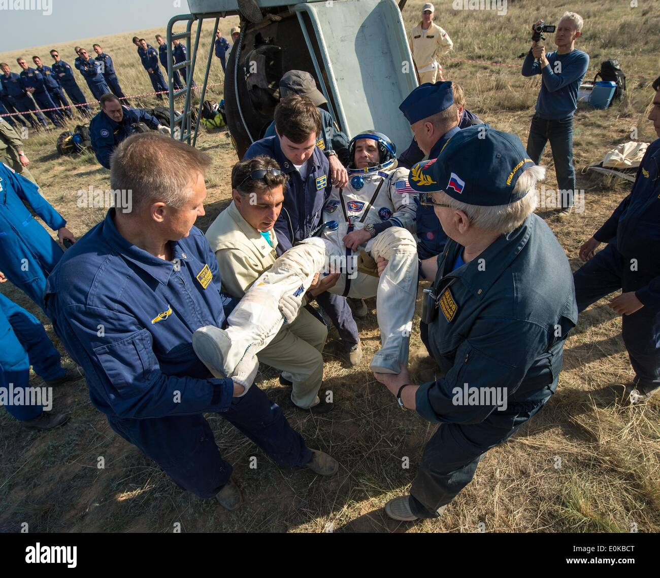ISS Expedition 39 Flight Engineer Rick Mastracchio of NASA is carried to the medical tent just minutes after landing with fellow expedition crew members in the Soyuz TMA-11M spacecraft May 14, 2014 near the town of Zhezkazgan, Kazakhstan. Wakata, Tyurin and Mastracchio returned to Earth after more than six months onboard the International Space Station where they served as members of the Expedition 38 and 39 crews. - Stock Image