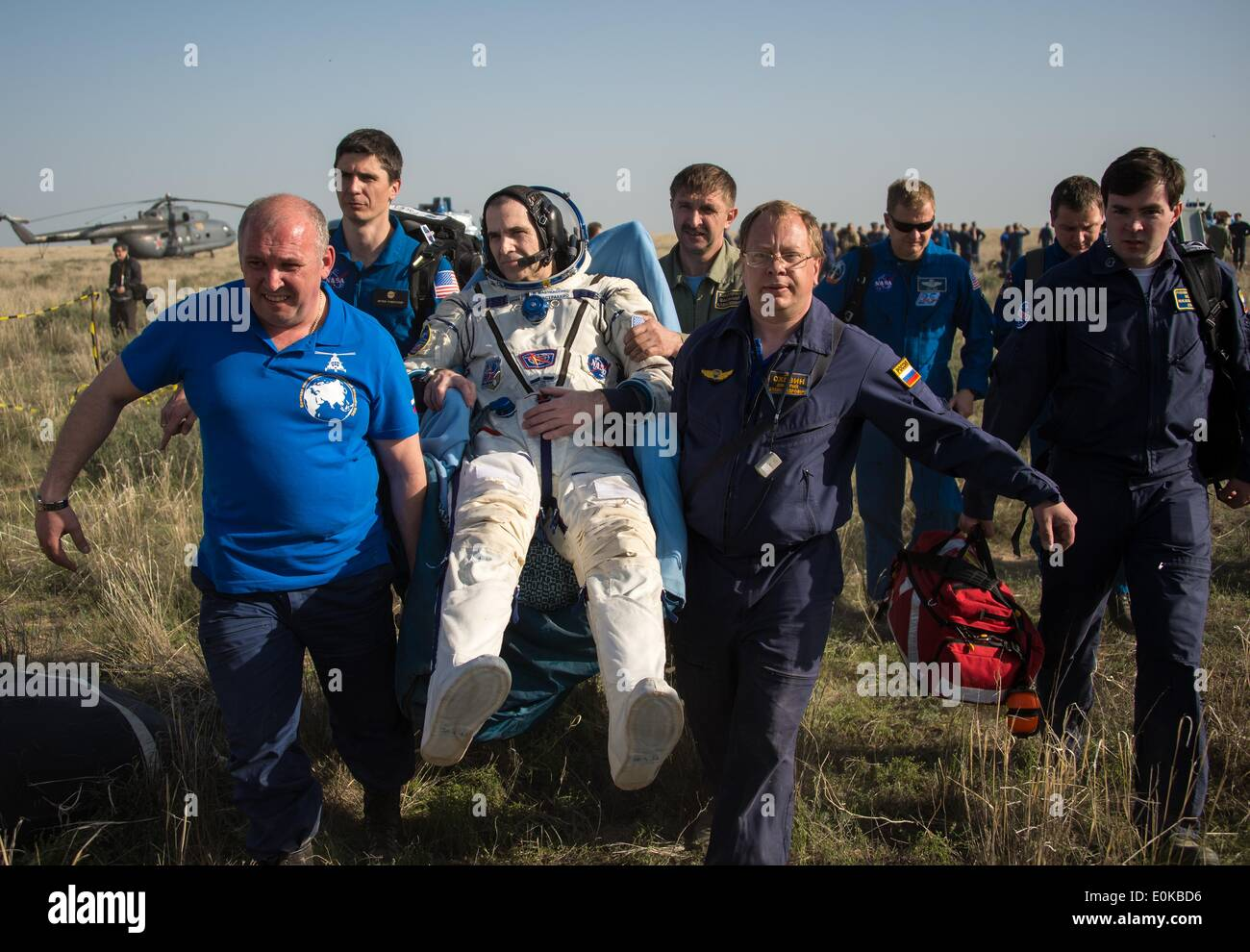 ISS Expedition 39 Flight Engineer Rick Mastracchio of NASA is carried in a chair to the medical tent just minutes after landing with fellow expedition crew members in the Soyuz TMA-11M spacecraft May 14, 2014 near the town of Zhezkazgan, Kazakhstan. Wakata, Tyurin and Mastracchio returned to Earth after more than six months onboard the International Space Station where they served as members of the Expedition 38 and 39 crews. - Stock Image