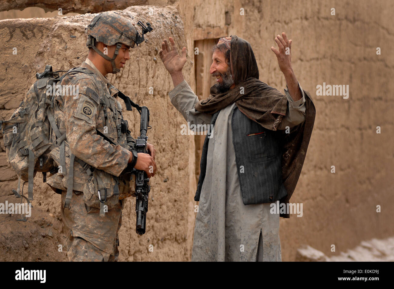 Private First Class Michael Elliott, Charlie Company 2508 Task Force Furry, talks with Mohammad Dode, a village Stock Photo