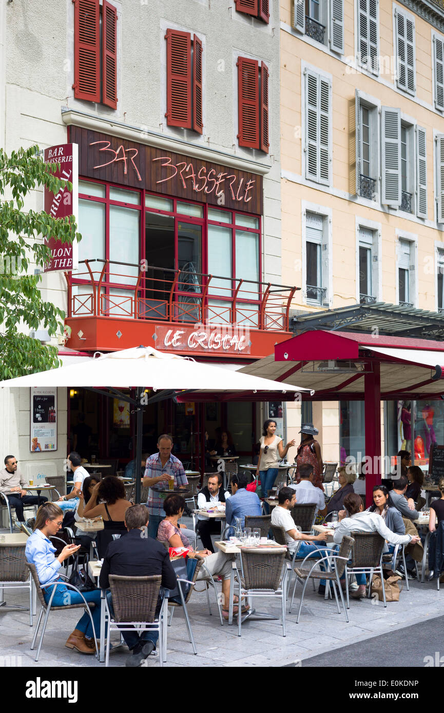 Diners at Le Cristal bar brasserie pavement cafe and Salon de The in rue Mal Joffre in Pau, the Pyrenees, France - Stock Image