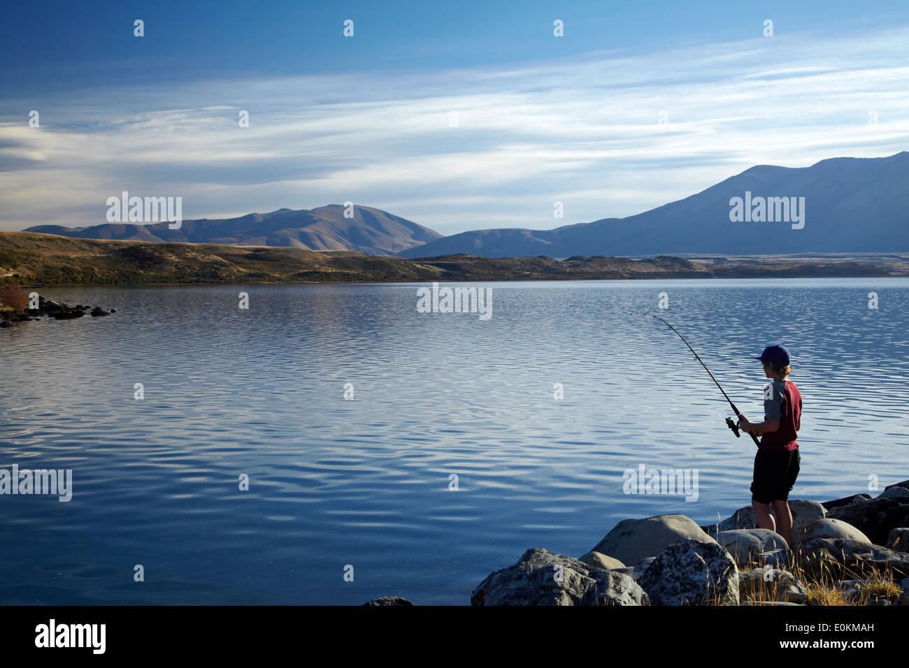 Boy fishing, Lake Ohau, Mackenzie Country, South Canterbury, South Island, New Zealand Stock Photo