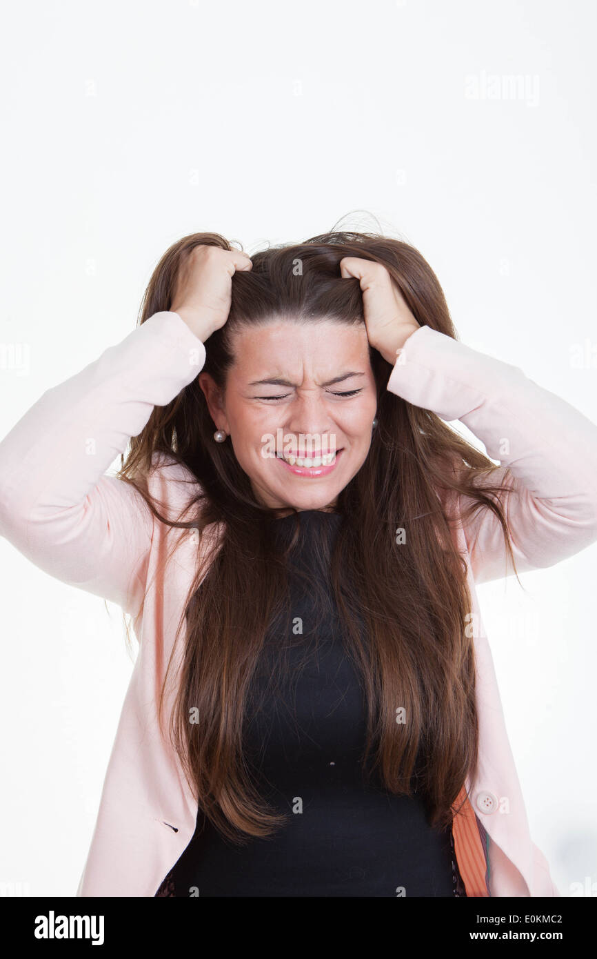 frustrated annoyed angry woman tearing hair out - Stock Image