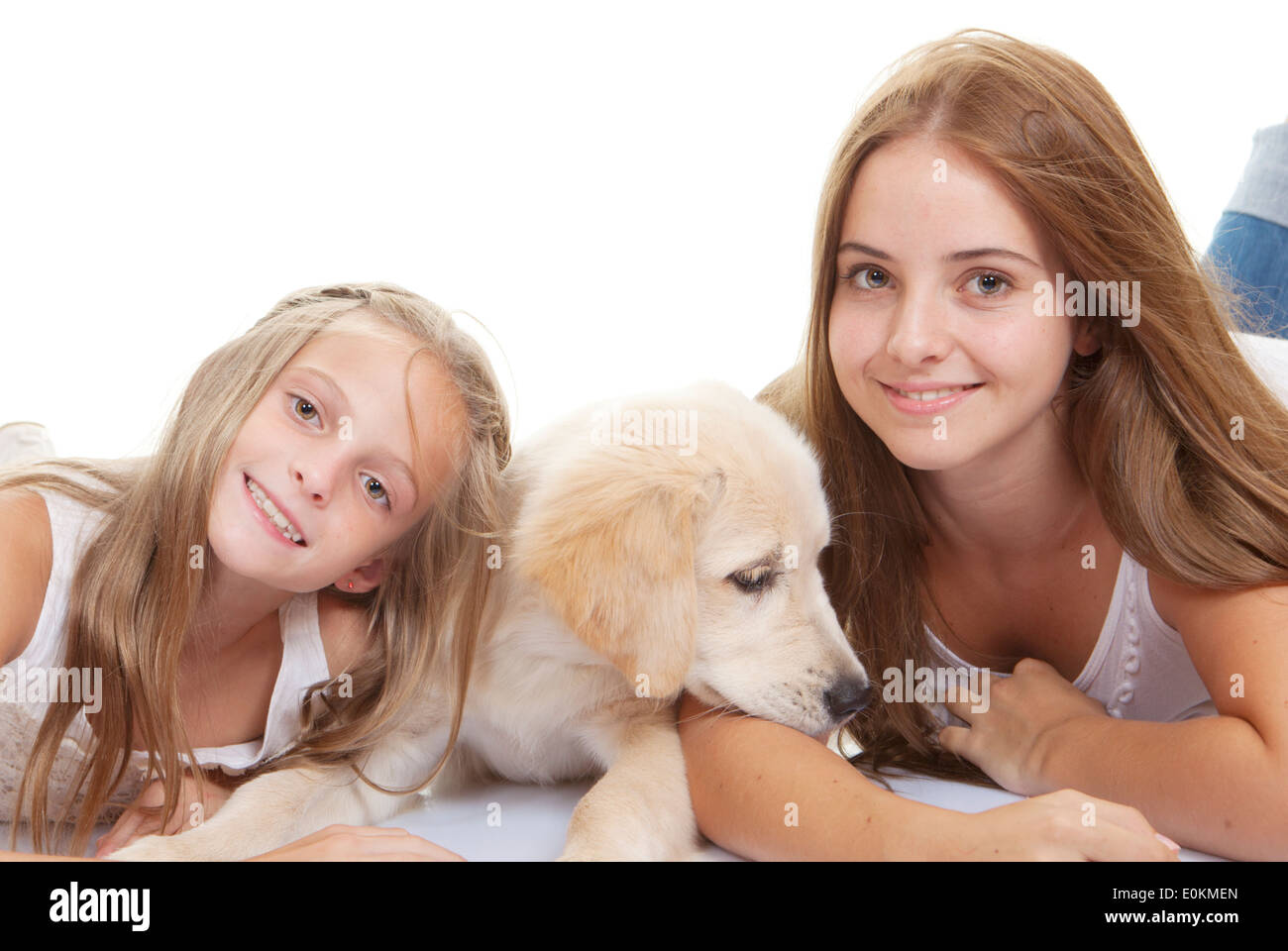 family pets pup with smiling girls - Stock Image
