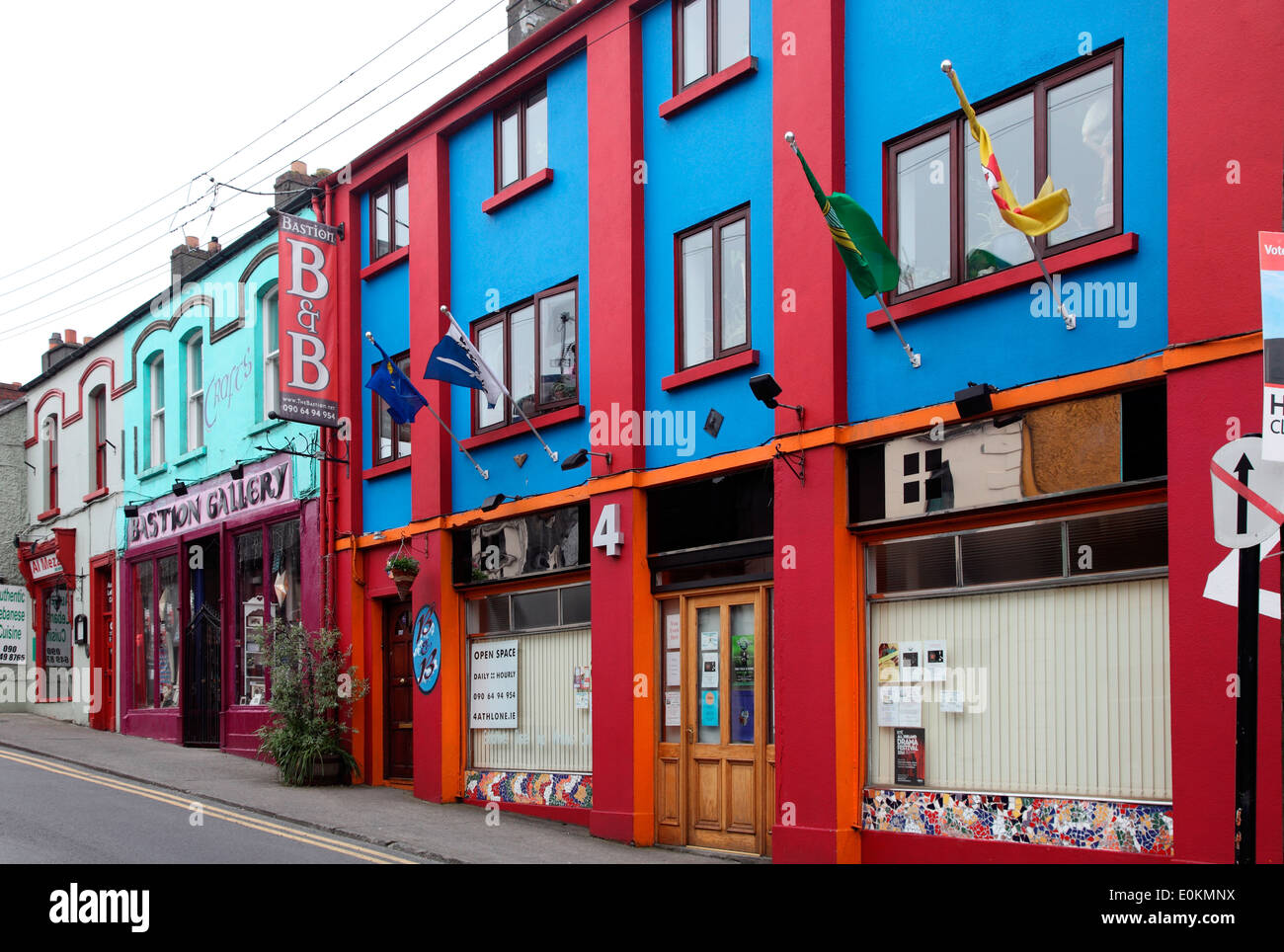 Athlone streetscape showing typical coloured shopfronts - Stock Image