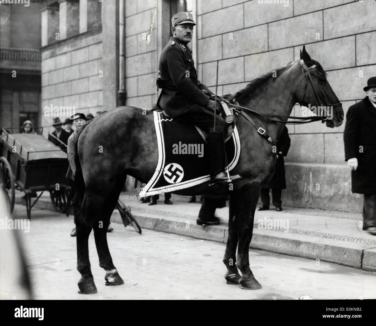 Nazi man on horseback in front of the Reichstag - Stock Image