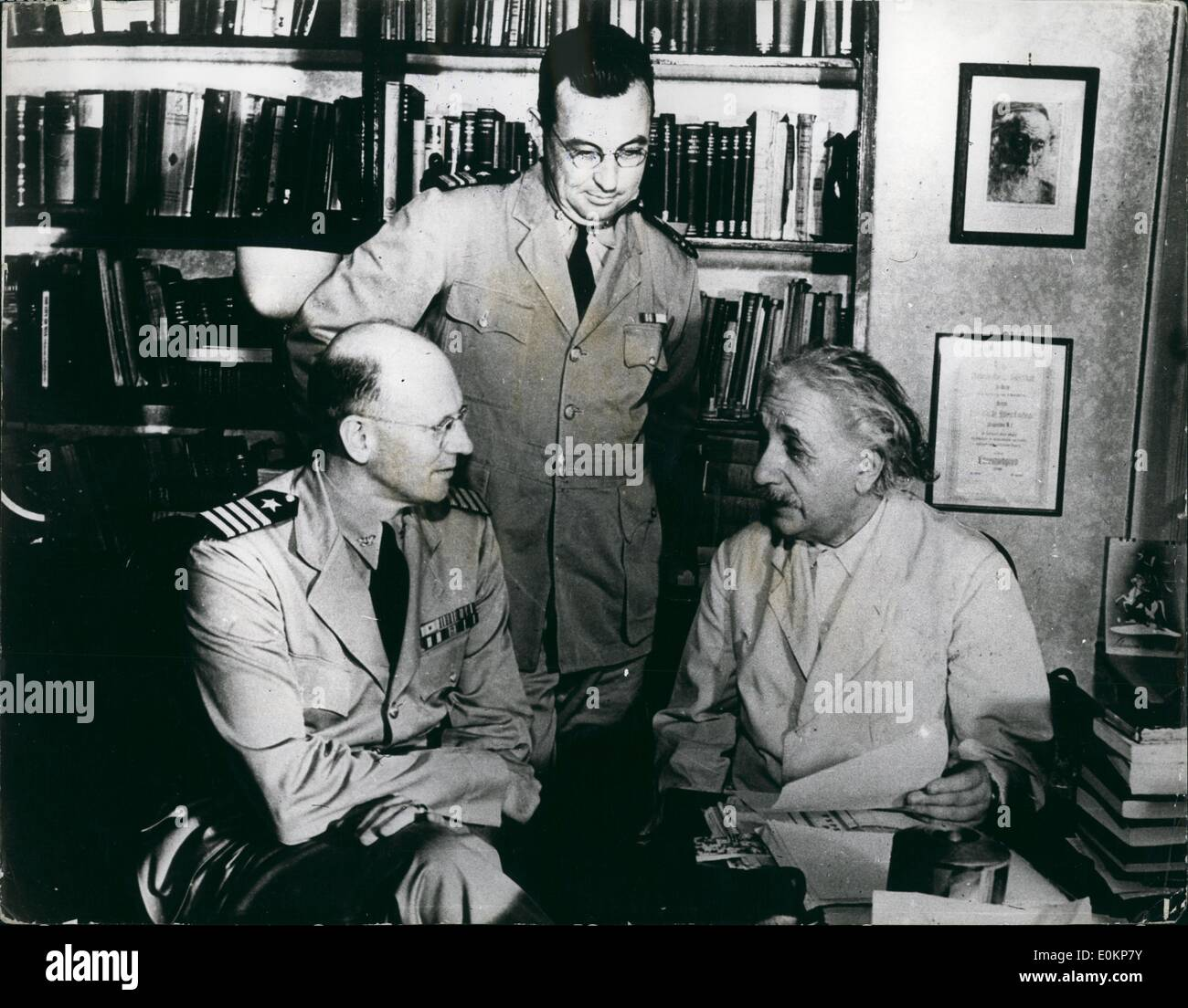 Oct. 10, 1943 - Falcous scientist now works for uncle sa passed by censor: Dr. Albert Einstein., German refugee and one of the world's most famous scientists, founder of the theory or relativity, is now refusing research work for the U.S.Navy. Photo shows L to R captain G.E.Sage, U.S.N. commanding officer of the U.S. Naval training school at Princeton, N.J. and Lt. commander F.L.Douthit, usher, executive officer of the school, pay a visit to the famous scientist, prof.Einstein, in his study at Princeton university. - Stock Image