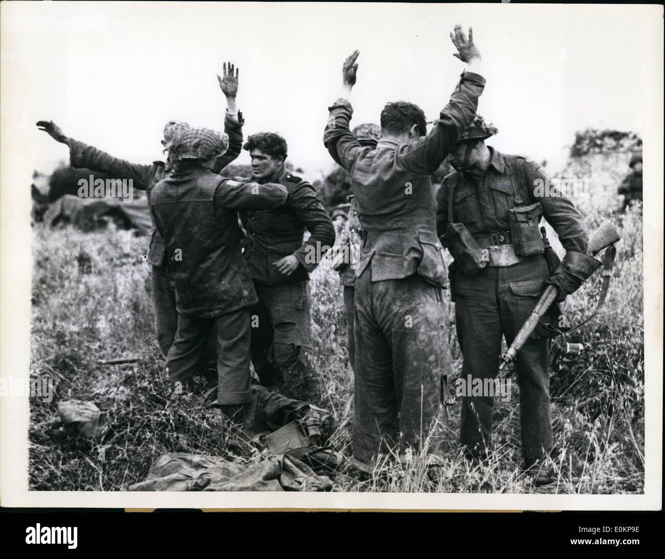 Jul. 07, 1944 - German Youths Taken Prisoner In France: Canadian Soldiers search youthful German prisoners who surrendered Stock Photo