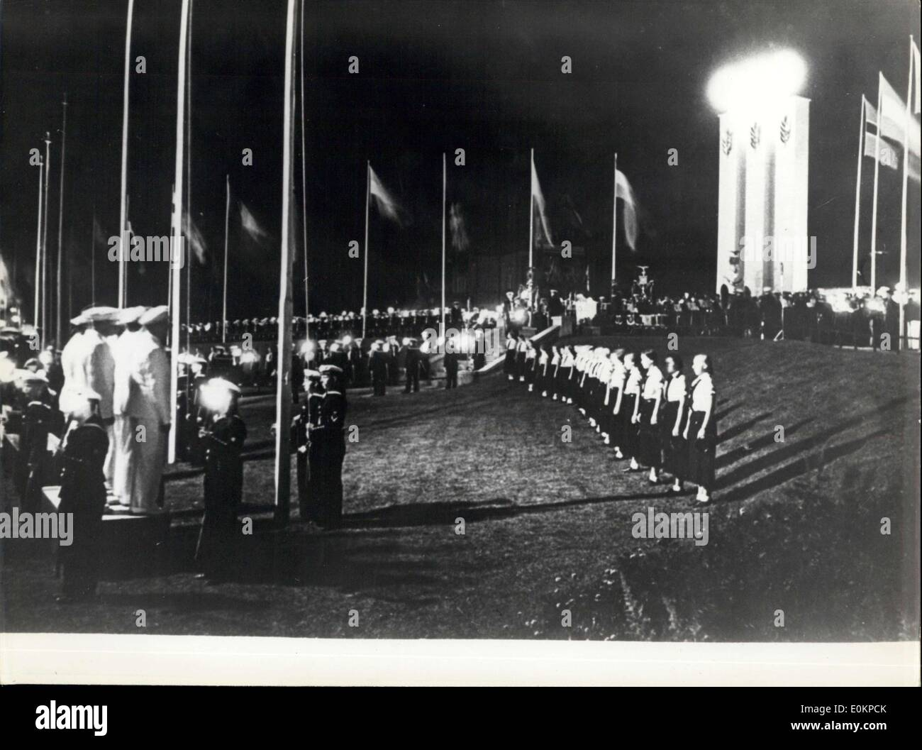 Mar. 05, 1936 - Kiel 1936 Closure for the yatching games, in presence of a big audience was closure ceremonies of yatching games, it took place at Pont Bellevue Square with all the Olympic all medal;s. (Left) Yatching players (right) a crown in-front of the players with me Olympic medals. - Stock Image